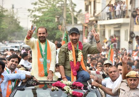 Bollywood actor and BJP Leader Sunny Deol with BJP Lok Sabha candidate for South Delhi Ramesh Bidhuri at a roadshow, in Chhatarpur on May 9, 2019 in New Delhi, India. All seven parliamentary constituencies of Delhi will be going to polls on May 8. Results will be declared on May 23.
