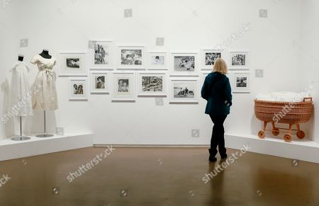 Stock Picture of A visitor looks at pictures which are part of the exhibition 'Intimate Audrey' at Espace Vanderborght Museum in Brussels, Belgium, 10 May 2019. 'Intimate Audrey' is an exhibition about the life of Audrey Hepburn created by her son, Sean Hepburn Ferrer, to celebrate her 90th birthday anniversary in her birth town, Brussels. The exhibition runs from 1 May 2019 until 25 August 2019.