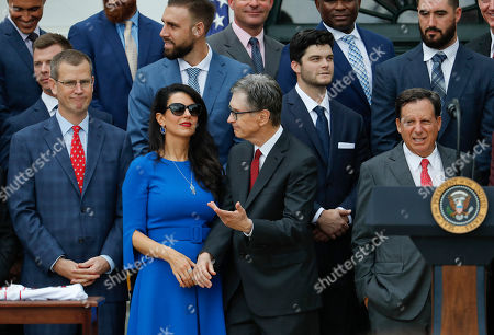 Red Sox Principal Owner John Henry, center, talks with his wife Linda Pizzuti, second from left and Sam Kennedy, far left, President and CEO of the Red Sox, as they wait for President Donald Trump to arrive for a ceremony on the South Lawn of the White House in Washington, where Trump will honored the 2018 World Series Baseball Champion Boston Red Sox. On the far right is Tom Werner, Chairman of the Red Sox
