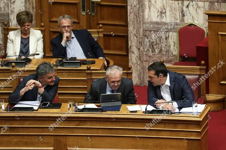 Stock Picture of Greece's Prime Minister Alexis Tsipras, right, speaks with Deputy Prime Minister Yannis Dragasakis, center, and Finance Minister Euclid Tsakalotos, during a parliamentary session in Athens, on. Greek lawmakers are holding a vote of confidence in the left-wing government, after Prime Minister Alexis Tsipras turned a censure motion against a junior minister into a test of his entire administration