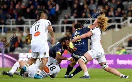 Camille Lopez of ASM Clermont Auvergne gives Thomas Jolmes of La Rochelle (Stade Rochelais) a taste of his elbow