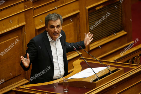 Greek Finance Minister Euclid Tsakalotos delivers his speech during a debate on the vote of confidence in the government, in the parliament's plenum, in Athens, Greece, 10 May 2019. Greek deputies will be called to give their vote of confidence in the government on 10 May midnight, after a two-day debate in parliament.