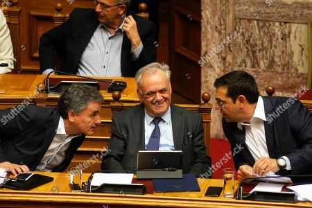 Greek Prime Minister Alexis Tsipras (R) talks with the deputy Prime Minister Yiannis Dragasakis (C) and Finance Minister Euclid Tsakalotos (L), during a debate on the vote of confidence in the government, in the parliament's plenum, in Athens, Greece, 10 May 2019. Greek deputies will be called to give their vote of confidence in the government on 10 May midnight, after a two-day debate in parliament.