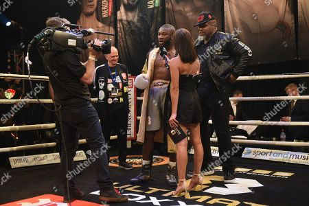 Derrick Osaze (grey shorts) with Shannon Briggs after defeating Grant Dennis during Ultimate Boxxer III at Indigo at the O2 London on 10th May 2019