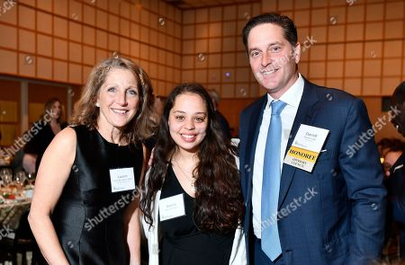 """Stock Photo of From left, Massachusetts First Lady Lauren Baker, Bianca Fonesca, who completed the Youth Leadership Program for Girls at Robert F. Kennedy Children's Action Corps, and Darrell Crate Founder and Managing Principal, Easterly Capital, Center, a winner of the 2019 """"Embracing the Legacy Award"""" on during the 50th anniversary gala at the John F. Kennedy Presidential Library in Boston. Crate was presented with the prestigious award by the RFK Children's Action Corps for his work on behalf of at-risk youth"""