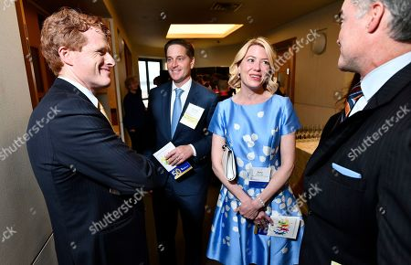 """Stock Image of From left, Congressman Joseph Kennedy III (D-MA), Darrell Crate Founder and Managing Principal, Easterly Capital, Center, a winner of the 2019 """"Embracing the Legacy Award"""" with, from left, his wife Amy Crate, and Board Member Keith Carroll speak on during a gala at the John F. Kennedy Presidential Library in Boston. Crate was presented with the prestigious award by the RFK Children's Action Corps for his work on behalf of at-risk youth"""