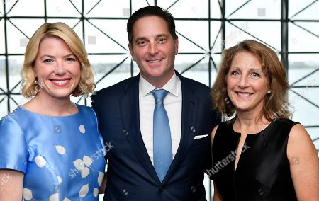 """Stock Picture of Darrell Crate Founder and Managing Principal, Easterly Capital, Center, who was honored with the 2019 """"Embracing the Legacy Award"""" from the RFK Children's Action Corps., with, from left, his wife Amy Crate, and Massachusetts First Lady Lauren Baker on during the 50th Anniversary RFK gala at the John F. Kennedy Presidential Library in Boston. Crate was presented with the prestigious award by the RFK Children's Action Corps for his work on behalf of at-risk youth"""