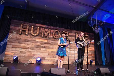 Stock Image of Kate Micucci; Riki Lindhome. Kate Micucci, left, and Riki Lindhome of the comedy duo Garfunkel and Oates seen at KAABOO Texas at AT&T Stadium, in Arlington, Texas