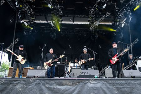 Stock Image of Cesar Rosas; Conrad Lozano; Enrique Gonzalez; Louie Perez; David Hidalgo; Steve Berlin. Cesar Rosas, from left, Conrad Lozano, Enrique Gonzalez, Louie Perez, David Hidalgo, and Steve Berlin of Los Lobos seen at KAABOO Texas at AT&T Stadium, in Arlington, Texas