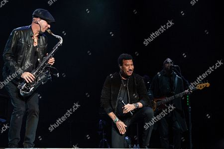 Lionel Ritchie slips in the rain and falls on stage at KAABOO Texas at AT&T Stadium, in Arlington, Texas