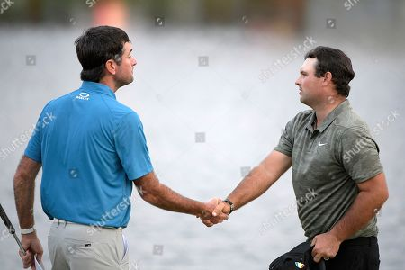 American track and field sprinter Noah Lyles trains at the National Training Center in Clermont, Florida. Bubba Watson, left, shakes hands with Patrick Reed after making their putts on the 18th green during the third round of the Arnold Palmer Invitational golf tournament, in Orlando, Fla