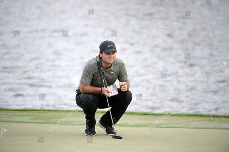 American track and field sprinter Noah Lyles trains at the National Training Center in Clermont, Florida. Patrick Reed lines up a putt on the 18th green during the third round of the Arnold Palmer Invitational golf tournament, in Orlando, Fla