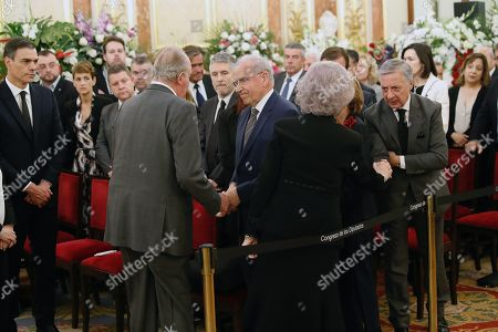 Spanish Emeritus King Juan Carlos (2-L) and Emeritus Queen Sofia (2-R) greet former Minister of Public Works Jose Blanco (R) and former deputy Prime Minister Alfonso Guerra (3-R) as acting Prime Minister Pedro Sanchez (R) looks on at the funeral chapel of Spanish former Minister Alfredo Perez Rubalcaba in the Lower House in Madrid, Spain, 11 May 2019. Rubalcaba, former Minister of Defense and Interior as well as former deputy chairman of the Socialist Party (PSOE), died 10 May 2019, two days after he suffered a stroke. The funeral chapel will be open until 14.00 local time 11 May 2019, and a private funeral with family and friends will be held 12 may 2019.