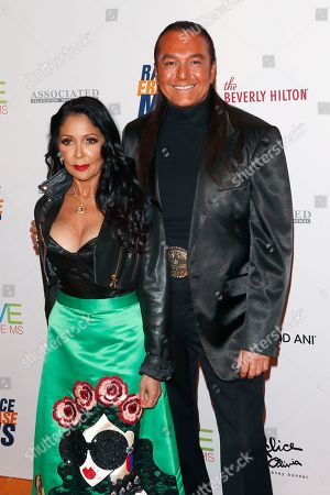 Stock Picture of Hairdresser to the star Nick Chavez and singer Apollonia Kotero arrive for the 26th Annual Race To Erase MS Gala at The Beverly Hilton Hotel, in Beverly Hills, California, USA, 10 May 2019. The gala raises money for Race To Erase MS and its center without walls program.