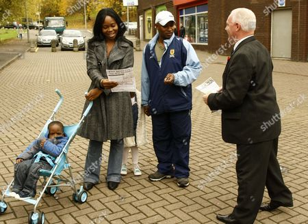 Charlie Baillie handing out leaflets to locals