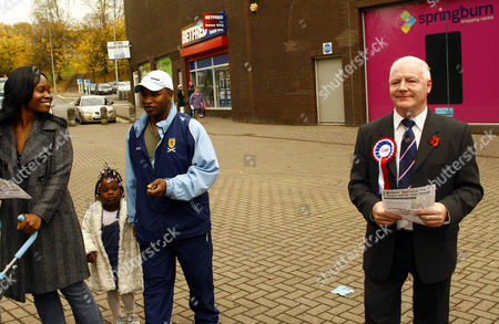 Stock Photo of Charlie Baillie hands out leaflets to locals