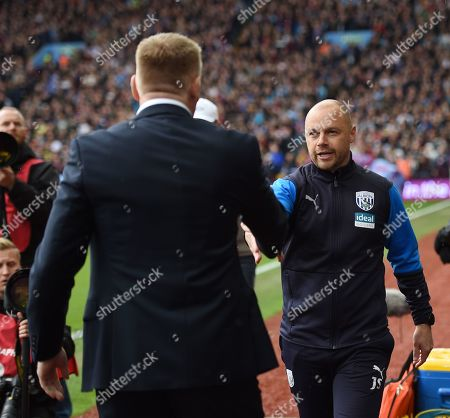 1st team coach James Shan of West Bromwich Albion shakes hands with Dean Smith Manager of Aston Villa.