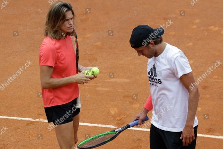 France's Lucas Pouille talks to his coach Amelie Mauresmo during a training session in view of the upcoming Italian Open tennis tournament, in Rome, Saturday, May, 11, 2019