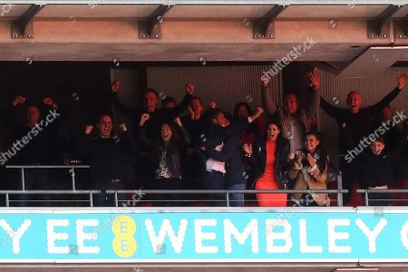 Gary Neville and Phil Neville and their families together with Peter Lim and Nicky Butt celebrate Salford City's Play-Off Final victory during AFC Fylde vs Salford City, Vanarama National League Football Promotion Final at Wembley Stadium on 11th May 2019