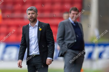 Motherwell manager Stephen Robinson looks shocked at a decision, as Tommy Wright, manager of St Johnstone FC smiles behind him during the Ladbrokes Scottish Premiership match between St Johnstone and Motherwell at McDiarmid Stadium, Perth