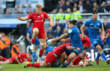 James Lowe of Leinster is hit hard by Brad Barritt of Saracens as Jackson Wray of Saracens leaps