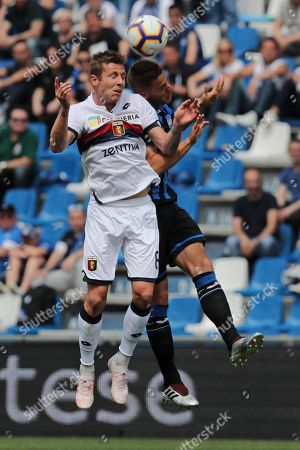 Atalanta's Mario Pasalic (R) and Genoa's Lukas Lerager during the Italian Serie A soccer match between Atalanta and Genoa at Mapei Stadium in Reggio Emilia, Italy, 11 May 2019.