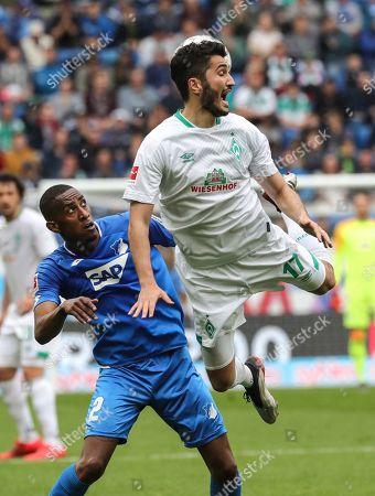 Hoffenheim's Joshua Brenet (L) in action against Bremen's Nuri Sahin during the German Bundesliga soccer match between TSG 1899 Hoffenheim and SV Werder Bremen in Sinsheim, Germany, 11 May 2019.