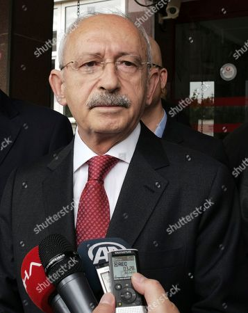 Kemal Kilicdaroglu, the leader of Turkey's main opposition Republican People's Party, speaks to the media after visiting Yavuz Selim Demirag, a Turkish journalist critical of President Recep Tayyip Erdogan's government and its nationalist allies, outside a hospital in Ankara, Turkey, . Yenicag newspaper says Saturday columnist Demirag was beaten by a group of about five or six people with baseball bats outside his home after appearing on a TV show late Friday