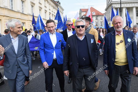 Former Polish President Aleksander Kwasniewski (2-R) takes part in the 20th Schuman Parade in Warsaw, Poland, 11 May 2019. The annual Schuman parade, under the motto 'We choose Europe' marks the international Europe Day, also known as Schuman Day, which is celebrated on 09 May.