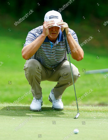Steve Stricker lines up his putt on the 17th during the third round of the Regions Tradition Champions Tour golf tournament, in Birmingham, Ala
