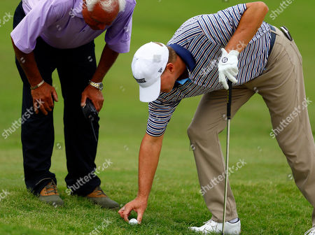 Steve Stricker, right, gets a ruling from a PGA official on the 18th hole during the third round of the Regions Tradition Champions Tour golf tournament, in Birmingham, Ala