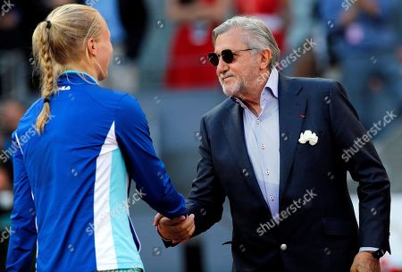 Kiki Bertens of the Netherlands shakes hands with Ilie Nastase of Romania