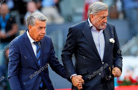 Stock Picture of Ilie Nastase of Romania helps Manolo Santana, holding his hand