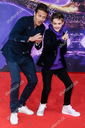Roman Knizka (L) and his son Leo attend the Aladdin gala screening in Berlin, Germany, 11 May 2019. Aladdin screens in German cinemas from 23 May 2019.