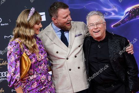 Guy Ritchie (C) and his wife Jacqui Ainsley (L) with US composer Alan Menken (R) attend the Aladdin gala screening in Berlin, Germany, 11 May 2019. Aladdin screens in German cinemas from 23 May 2019.