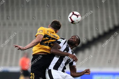 PAOK's Fernando Lopes dos Santos Varela, right, struggles for the ball against AEK Athens' Ezqquiel Ponce, during the Greek Cup final soccer match at the empty of fans Olympic stadium in Athens