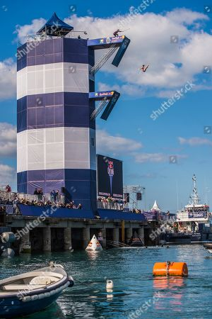 Andy Jones of the United States dives from the 27 metre platform at Dun Laoghaire Harbour during first competition day of the second stop of the Red Bull Cliff Diving World Series