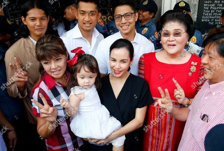 """Imee Marcos, Imelda Marcos, Ferdinand """"Bongbong"""" Marcos Jr. In this photo, photo, Imee Marcos, left front, the eldest daughter of ousted Philippine dictator Ferdinand Marcos, poses with her family, including her mother and former First Lady Imelda Marcos, second from right, and brother Ferdinand """"Bongbong"""" Marcos Jr., right, as she files her certificate of candidacy for senator at the Commission on Elections in Manila, Philippines. President Rodrigo Duterte's name is not on the ballot but Monday's mid-term elections are seen as a referendum on his phenomenal rise to power, marked by his gory anti-drug crackdown and his embrace of China"""