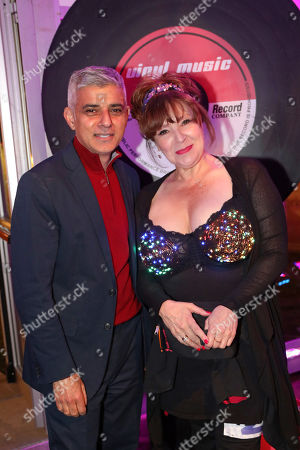 The Mayor of London, Sadiq Khan, with Walk the Walk Ambassador Harriet Thorpe at the Walk the Walk Moonwalk charity marathon wearing bras, London, UK. Thousands of people walked either a full or half marathon round London wearing bras to raise money and awareness for breast cancer charity Walk the Walk, passing many London landmarks, some of which were illuminated pink for the marathon. The theme this year was Disco Inferno and many participants decorated their bras with disco lights and sequins.