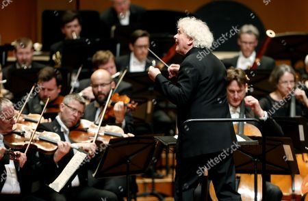 Simon Rattle (C) and the London Symphony Orchestra's members perform during a concert at the Teatro Mayor Julio Mario Santo Domingo, in Bogota, Colombia, 11 May 2019.