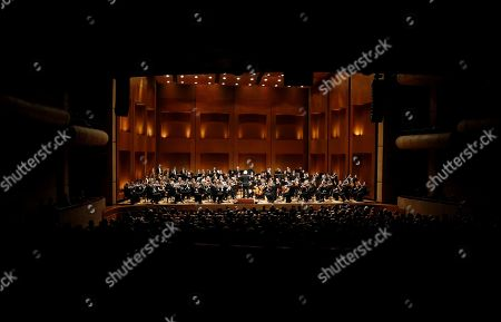 Stock Photo of Simon Rattle and the London Symphony Orchestra's members perform during a concert at the Teatro Mayor Julio Mario Santo Domingo, in Bogota, Colombia, 11 May 2019.