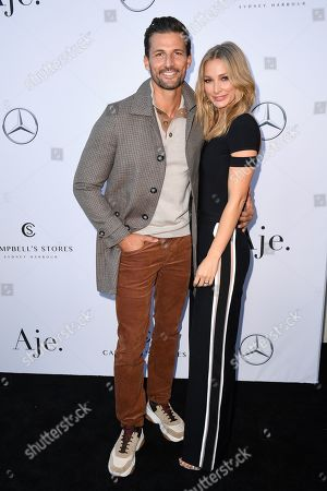 Tim Robards (L) and Anna Heinrich attend the Aje show during the Mercedes-Benz Fashion Week Australia in Sydney, 12 May 2019. The fashion event runs from 12 to 17 May.