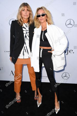 Claire Tregoning (L) and Pip Edwards attend the Aje show during the Mercedes-Benz Fashion Week Australia in Sydney, 12 May 2019. The fashion event runs from 12 to 17 May.