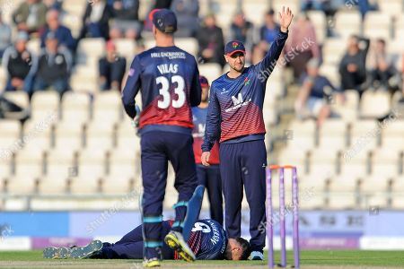 Stock Image of James Anderson of Lancashire lying injured on the pitch as he surrounded by team-mates after taking a blow to the knee during the Royal London One Day Cup semi-final match between Hampshire County Cricket Club and Lancashire County Cricket Club at the Ageas Bowl, Southampton