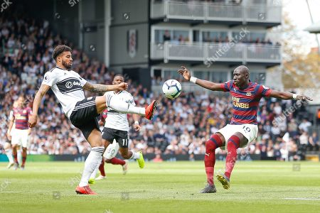 Fulham defender Cyrus Christie (22) and Newcastle United midfielder Mohamed Diame (10) battle for possession during the Premier League match between Fulham and Newcastle United at Craven Cottage, London