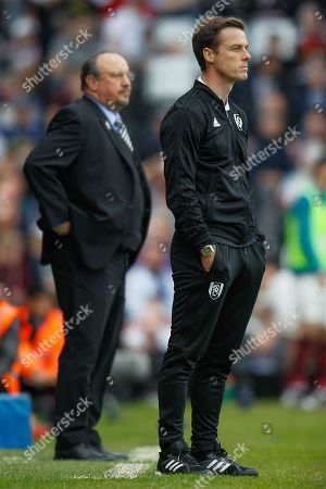 Newcastle United manager Rafa Benitez and Fulham caretaker manager Scott Parker during the Premier League match between Fulham and Newcastle United at Craven Cottage, London