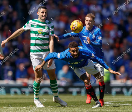 Connor Goldson of Rangers heads clear from Tom Rogic of Celtic