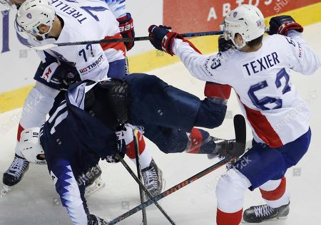Stock Photo of Alexandre Texier of France, right, checks Derek Ryan of the US, left, during the Ice Hockey World Championships group A match between the United States and France at the Steel Arena in Kosice, Slovakia