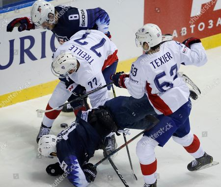 Alexandre Texier of France, front right, checks Derek Ryan of the US, front left, as Adam Fox of the US, back, challenges Sacha Treille of France, center, during the Ice Hockey World Championships group A match between the United States and France at the Steel Arena in Kosice, Slovakia
