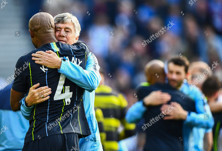 Vincent Kompany of Manchester City celebrates with Brian Kidd